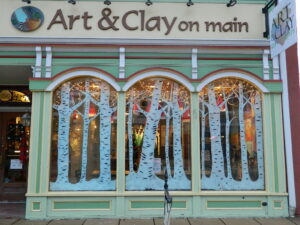 Holiday window display with white trees