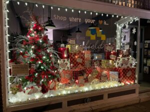 Holiday window display with package and a Christmas tree