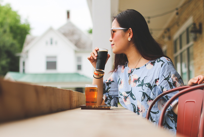 A woman drinking on the patio at Combustion Brewery.