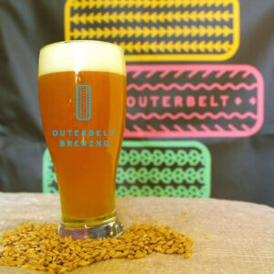 A tall glass of frothy Outerbelt Brewing beer