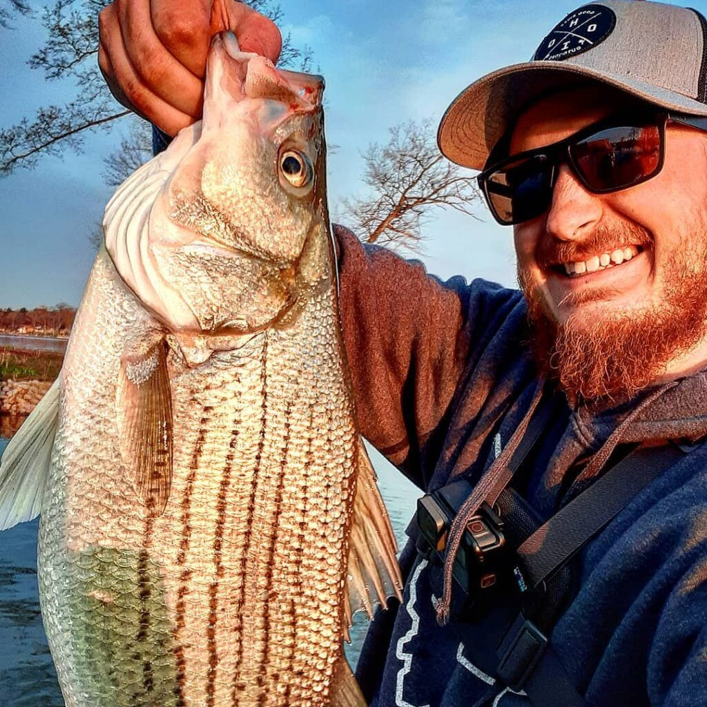 A bearded man holds up a fish at Buckeye Lake.