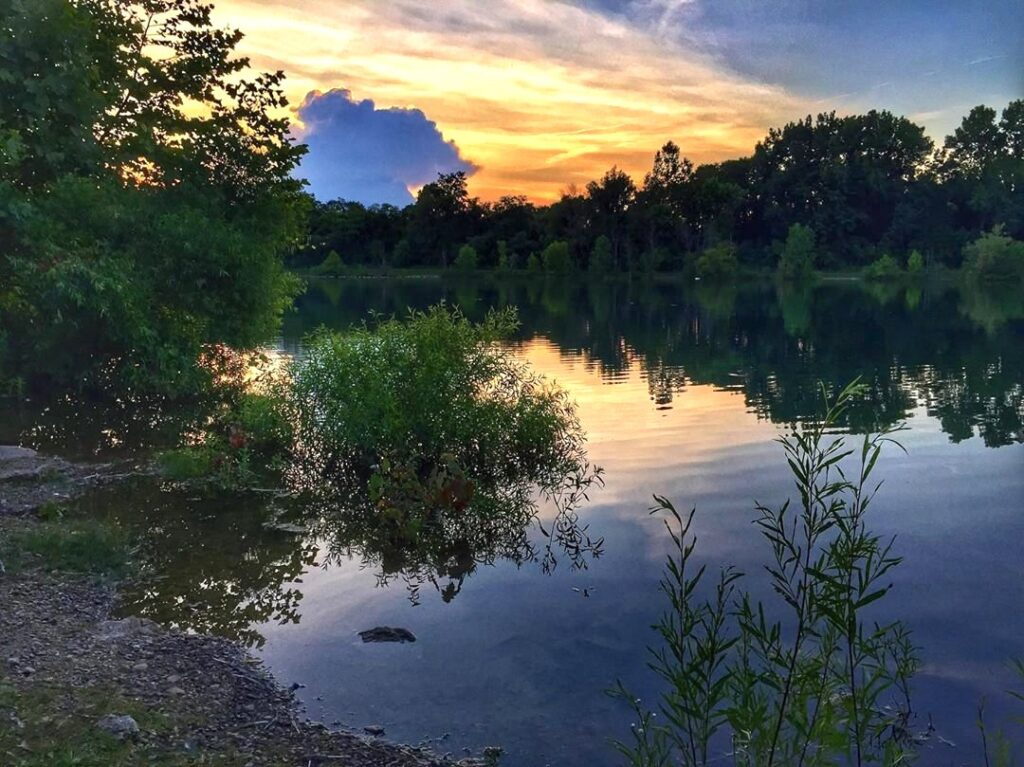 A pond at Cenci Park at sunset.