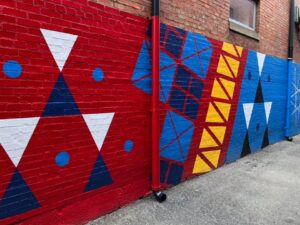 mural of shapes on an outside wall