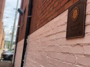 rotary sign on a primed brick wall