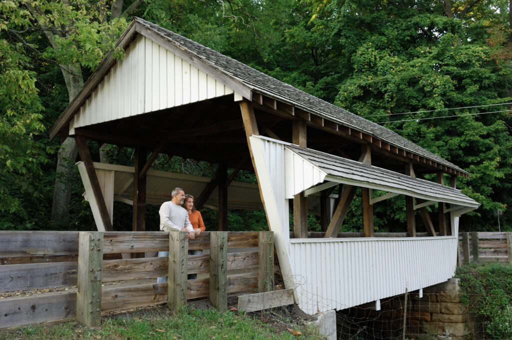 Greg Haungs and Terese Agosta take in the view from the covered bridge at Rock Mill.